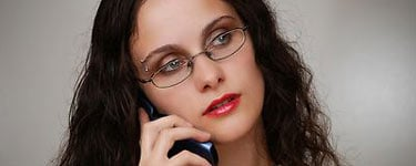 Woman on phone giving drug and alcohol rehab advice and help