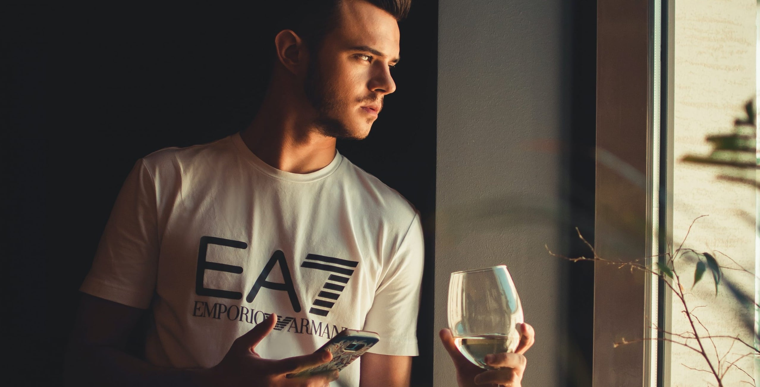 Man Drinking In Isolation with phone
