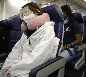 airline passenger with protective clothing