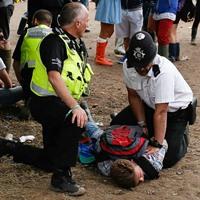 police restraining festival goer