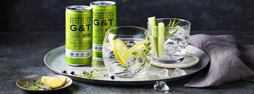 Two cans of alcohol-free G&T with glasses