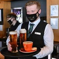 server with beer and coffee