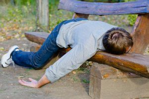Man passed out on park bench