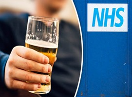 person holding pint of beer with NHS sign