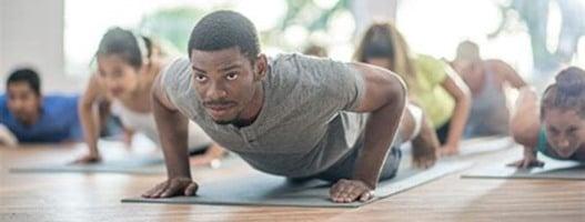 Black man at yoga class